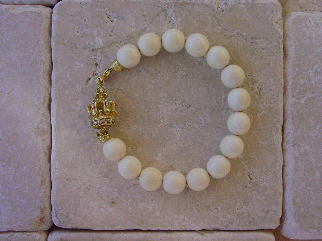 Gold Diamond Crown & Coral Beads by Roman Paul