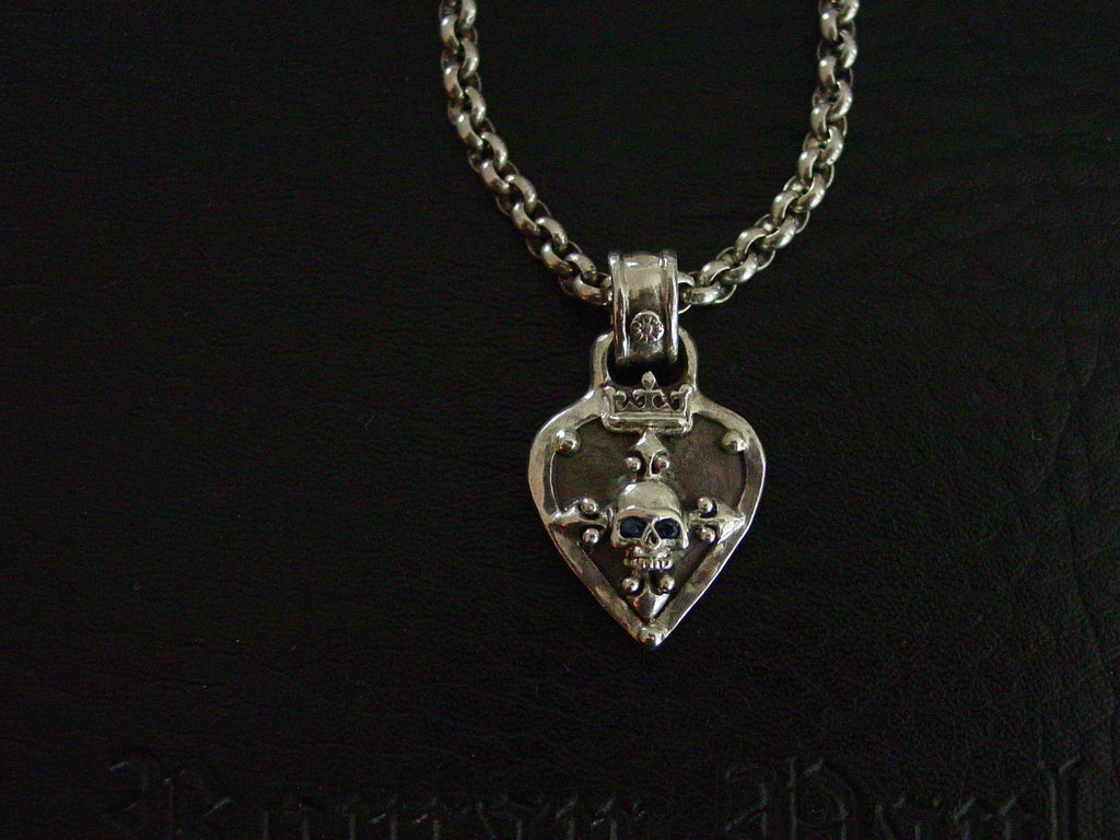 Necklace-sterling silver guitar pick with skull and black diamonds by Roman Paul