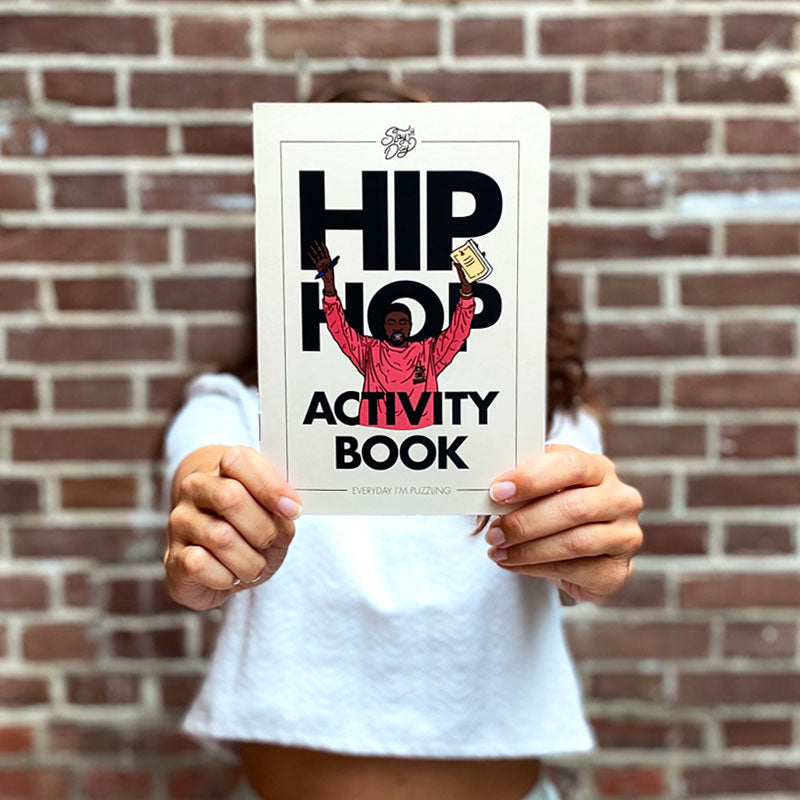 girl holding hip hop activity book