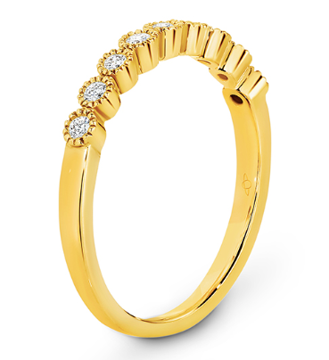 yellow gold diamond eternity ring with millgrain edge