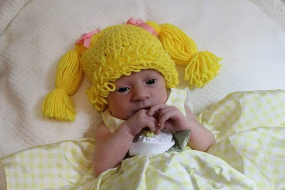 Crochet baby hat. Make her look like your favorite doll.