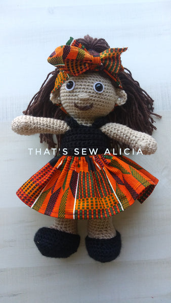 Crochet doll with African print skirt
