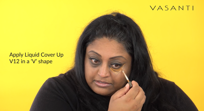 Woman applying Vasanti Cover Up Foundation and Concealer in 1 - Shade V12 on her under eye