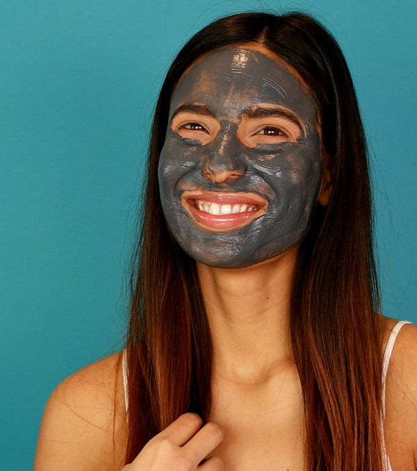 A girl's face covered in Vasanti Brighten Up! Miracle Mask.