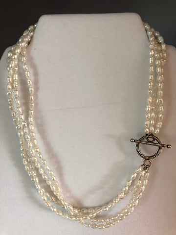 4 STRANDS OF WHITE FRESHWATER PEARLS