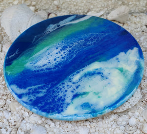 resin turntables in various sea and beach themed ideas.  beach decor and style,  beach house, beach home decor,  sea home decor, beach inspired decor,  beach inspired resin art, beach resin art,  beach life style,  ocean art, ocean decor,  ocean beach, ocean treasures, Ocean reef resin art gift ware,  Ocean Inspired Resin Artwork, Ocean inspired resin artwork is created on top of a pine board turntable.  Easy to turn for the perfect cheese platter for entertaining.