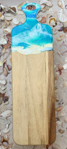 Sea Blue, green and white resin poured on handle of acacia wood cheese board to look like the ocean.
