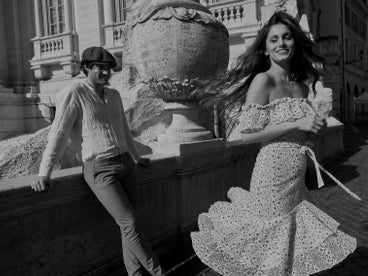 Woman smiling and walking away from a man in Italy