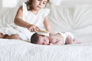 newborn wooden hair brush