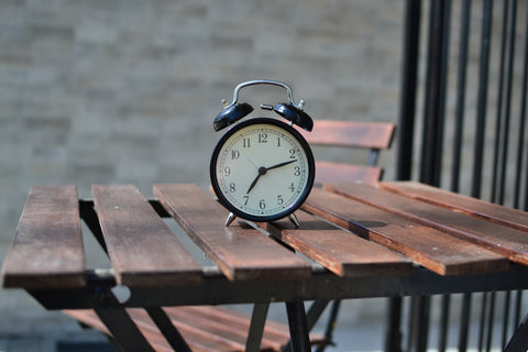 Classic two-bell alarm clock on wood table
