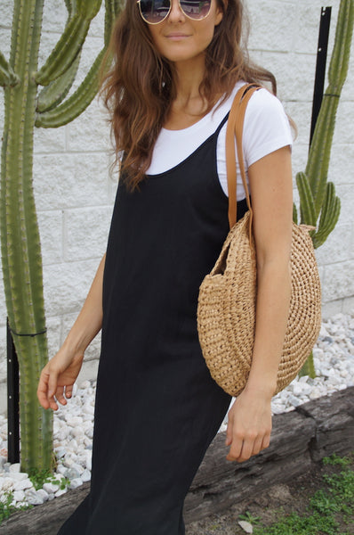 little lies the label Bahama dress in black. linen rayon blend