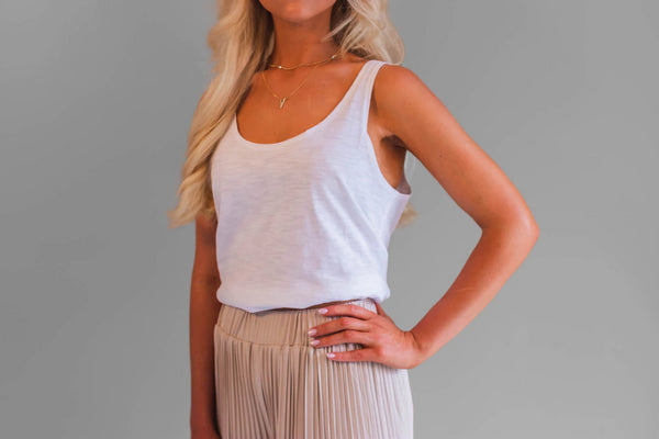 The Carly top is the must have essential for every wardrobe. It's 100% cotton slub tank style. Featuring a longer line which makes it incredibly versatile. It is also slightly oversized.
