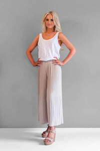 The Milan in beige pants are you new best friend. They are a pleated culotte style featuring an elastic waist which makes them extremely easy to wear. They are light weight and have a wide leg.