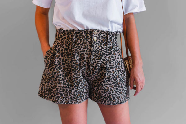 The Bree shorts in leopard are a must have for your summer wardrobe. Featuring front and back pockets, elastic back waist, button and zipper fly and belt loops, these shorts have it all.