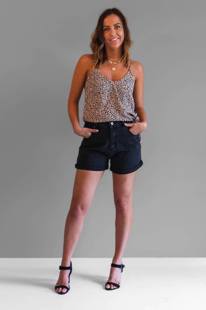 The Claire shorts are the perfect denim shorts to any summer wardrobe. Featuring a turn cuff, front and back pockets, zip fly, button waist and belt loops these shorts have it all.