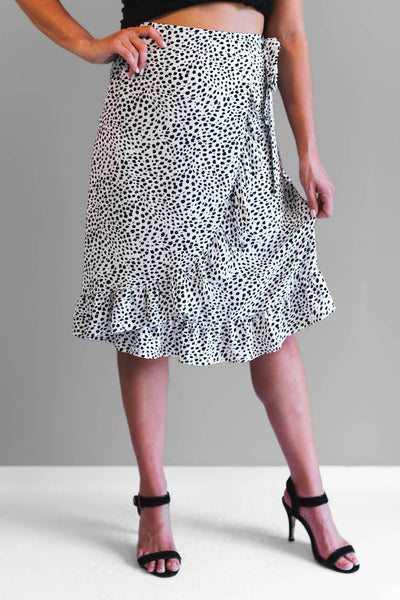 The Jessy skirt is a mid length skirt featuring a wrap front, tie side, invisible side zip, front frill. This beautiful skirt is fully lined.