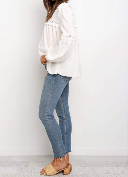 white Carrie top has long sleeves with elastic cuffs and lace detailing