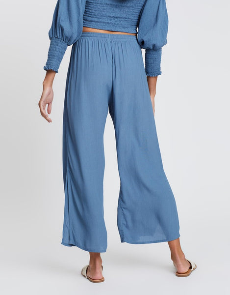 cartel and willow anju pants in steel blue. Featuring side split at leg, elasticated waistband and drawstring