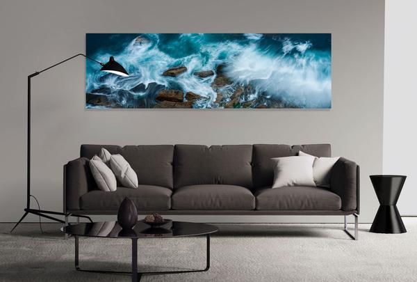 Seascape acrylic photo print above dark sofa