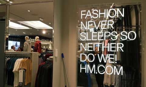 "H&M Commercial Bay Store Window ""Fashion Never Sleeps So Neither Do We! HM.com"""
