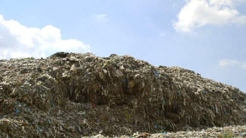 Still from 'The True Cost' (2015) of a mound of textile waste