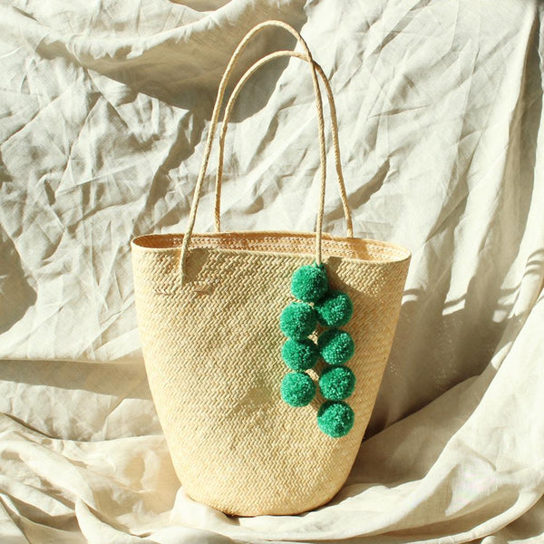 Borneo Serena Straw Tote Bag with Green Pom-poms Brunna Co - ourCommonplace