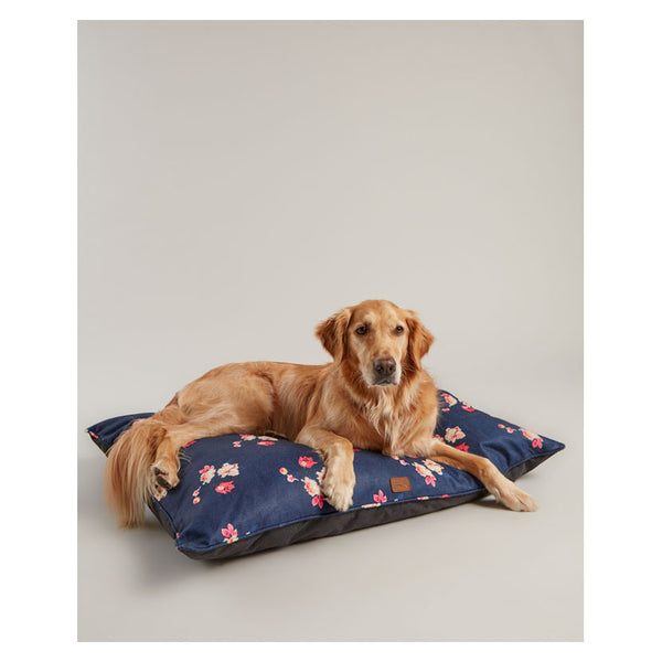 Dog lying on floral dog mattress