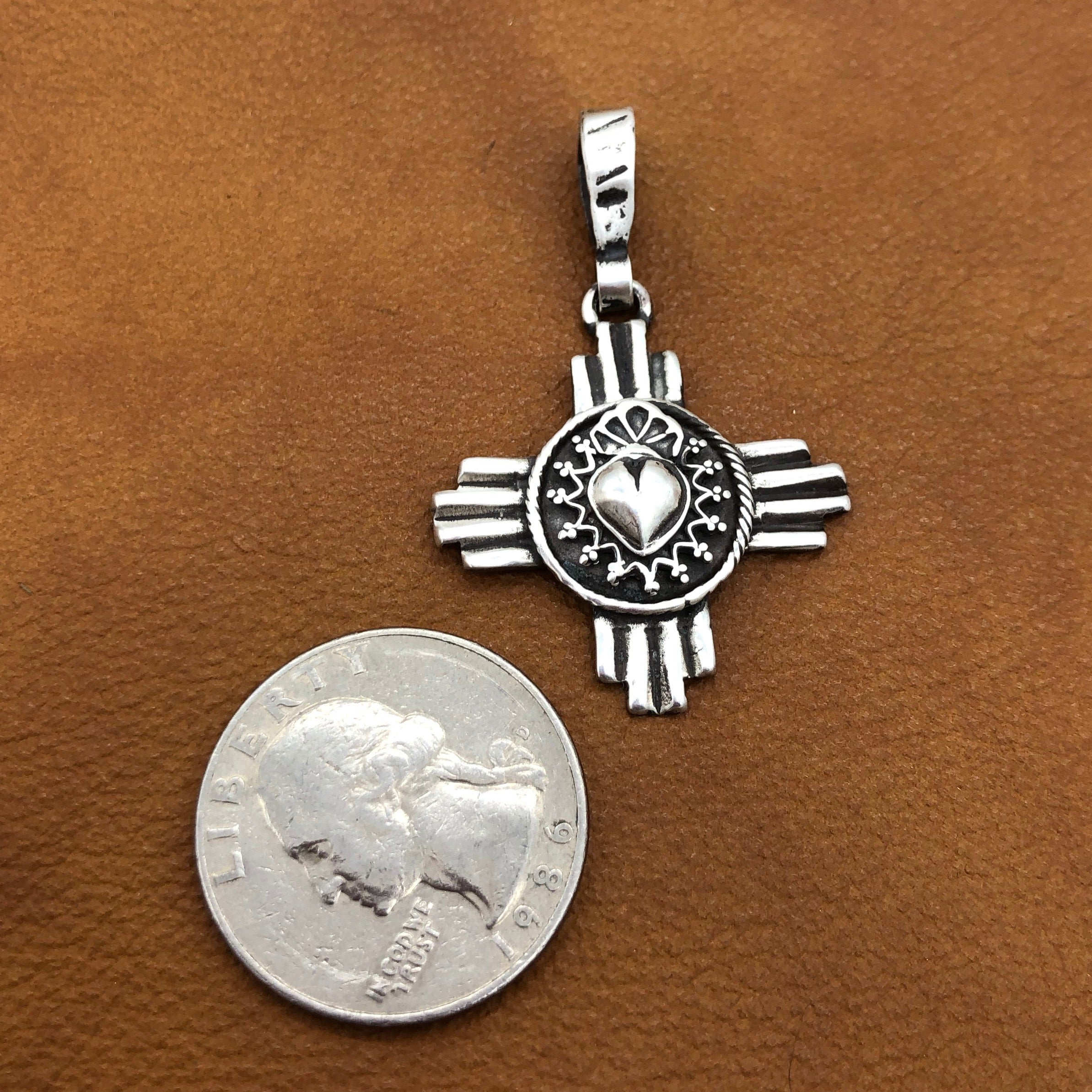 PTZ14H Zia with Taos Heart Silver Pendant