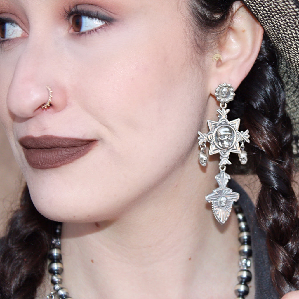 E211 Nambe Cross with Skulls Earrings