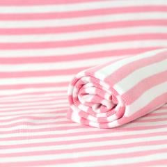 Ribbing in light pink and white stripes organic cotton knit fabric