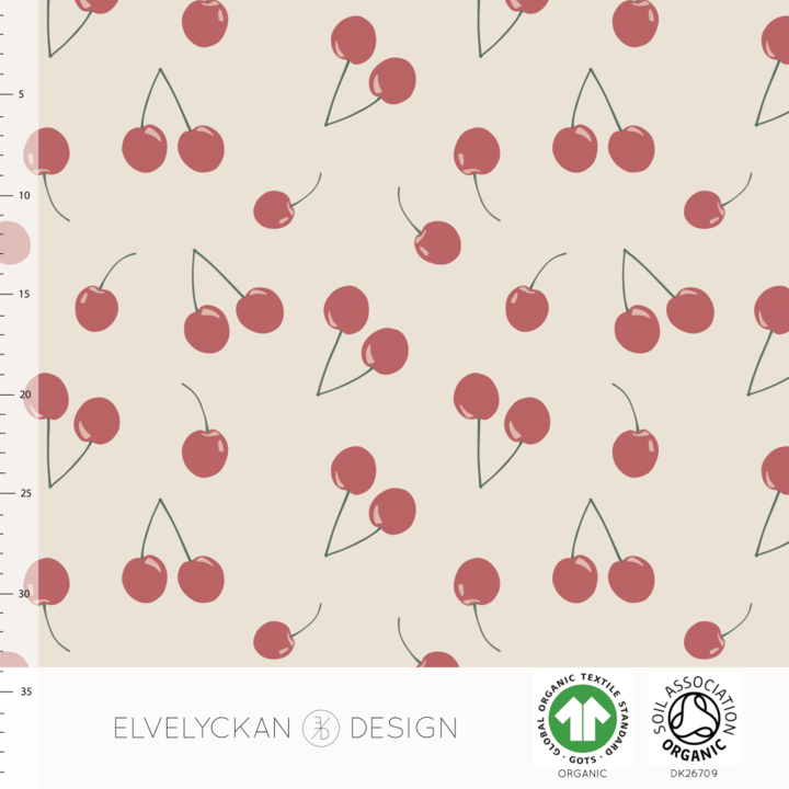 Cherries in creme organic cotton jersey knit fabric