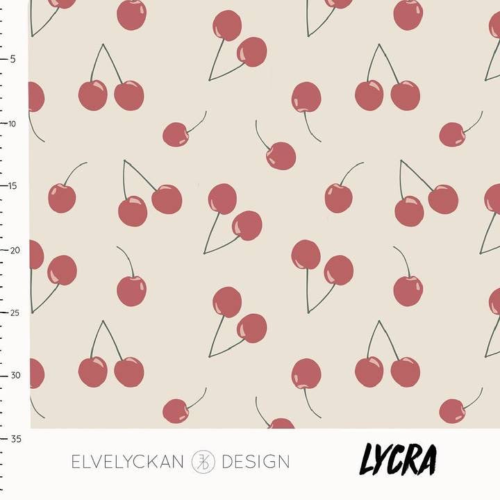 Cherries in cream lycra swim fabric or activewear