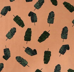Banana leaves in sandstorm organic cotton jersey knit fabric