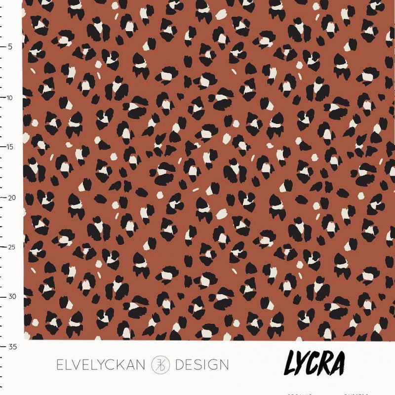Lynx dots in rusty lycra swim fabric or activewear