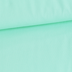 Solid mint organic cotton jersey knit fabric