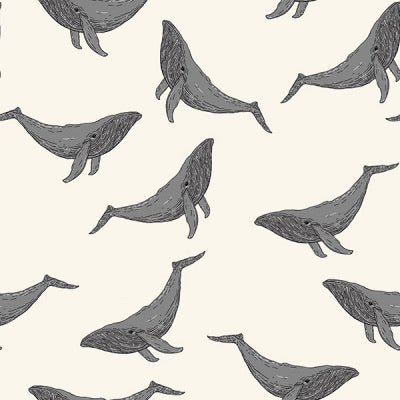 Whales in marshmallow organic cotton jersey knit fabric