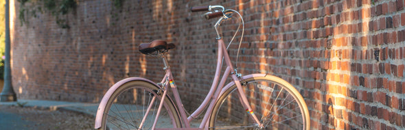 A woman on a PUBLIC step-through bikes. The best beach cruiser step-through bicycles.