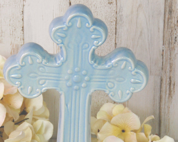 Light blue ceramic free-standing cross figurine