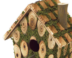 Whimsical wood birdhouse with green moss accents