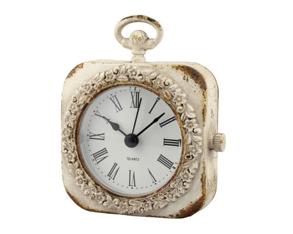 Small weathered white tabletop clock
