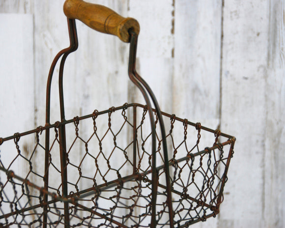Rustic two-tiered metal display basket stand