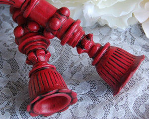 Ornate red holiday candlestick holders for the home