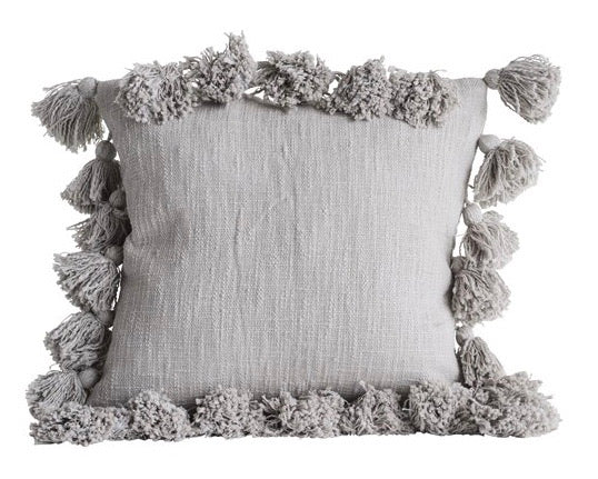 Decorative gray throw pillow with tassels