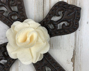 Ornate ivory embellished wrought iron wall hanging cross
