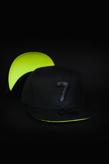 CMPD NEW ERA '7' BLACK/NEON GREEN SNAPBACK