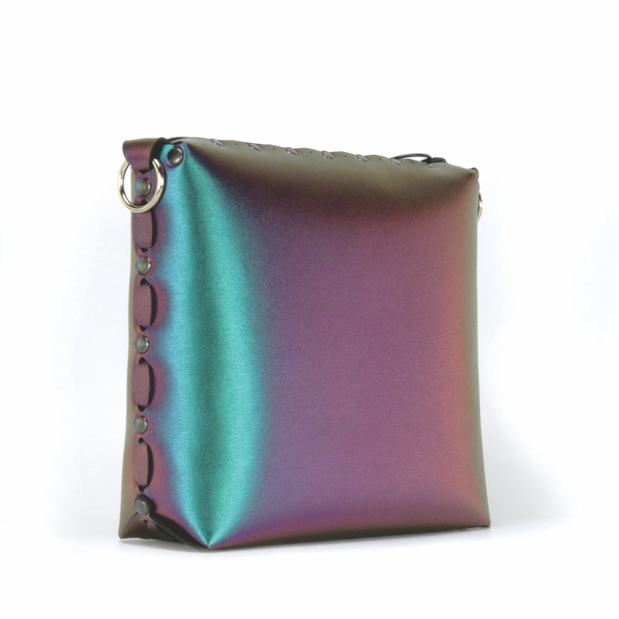 Side front view of chameleon medium crossbody bag