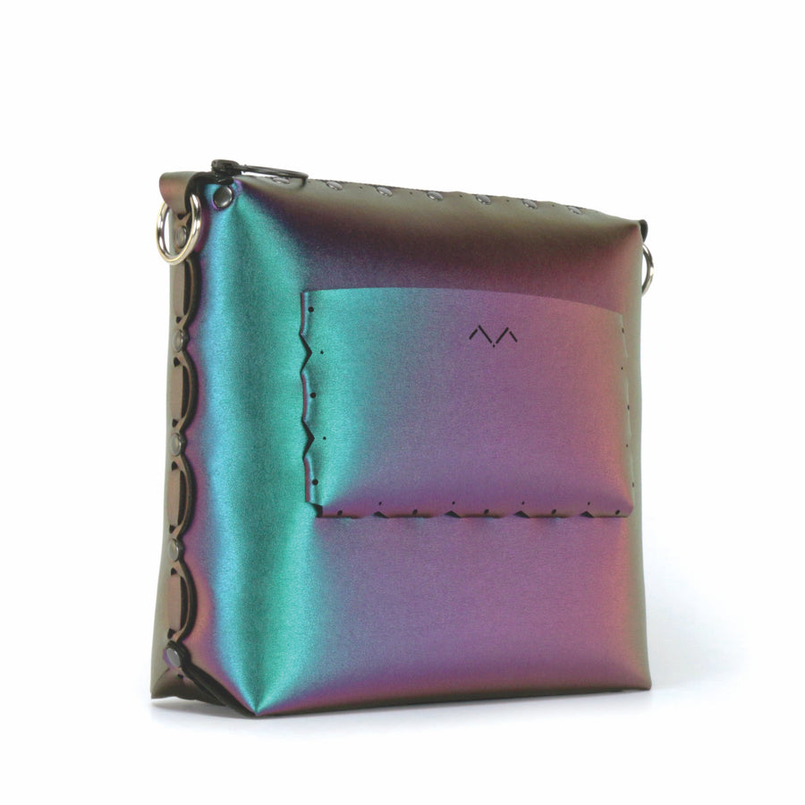 View of outside pocket of chameleon medium crossbody bag