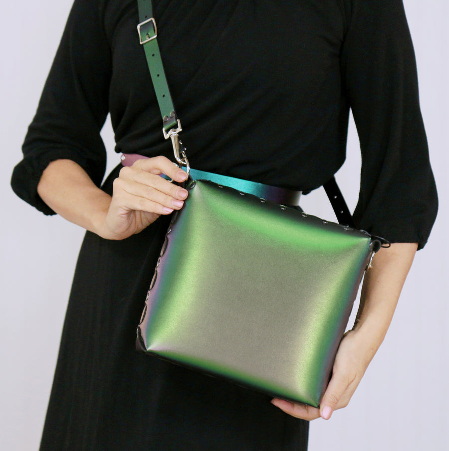 Model wearing emerald medium crossbody bag