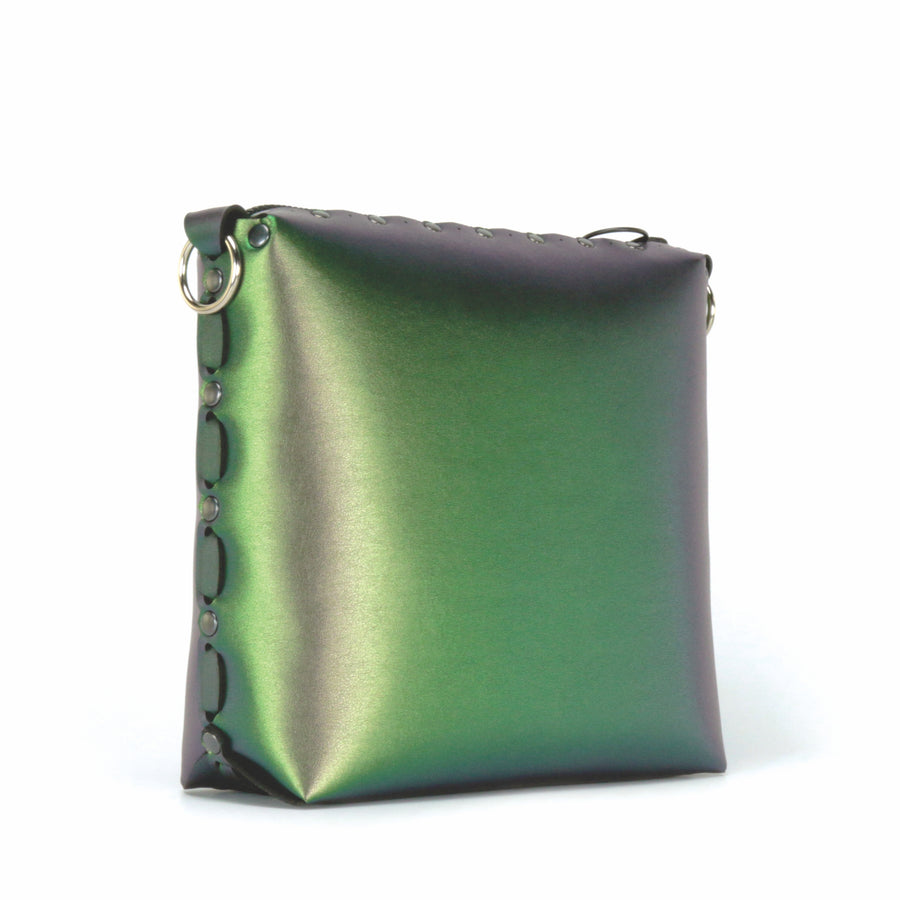 Side front view of emerald medium crossbody bag