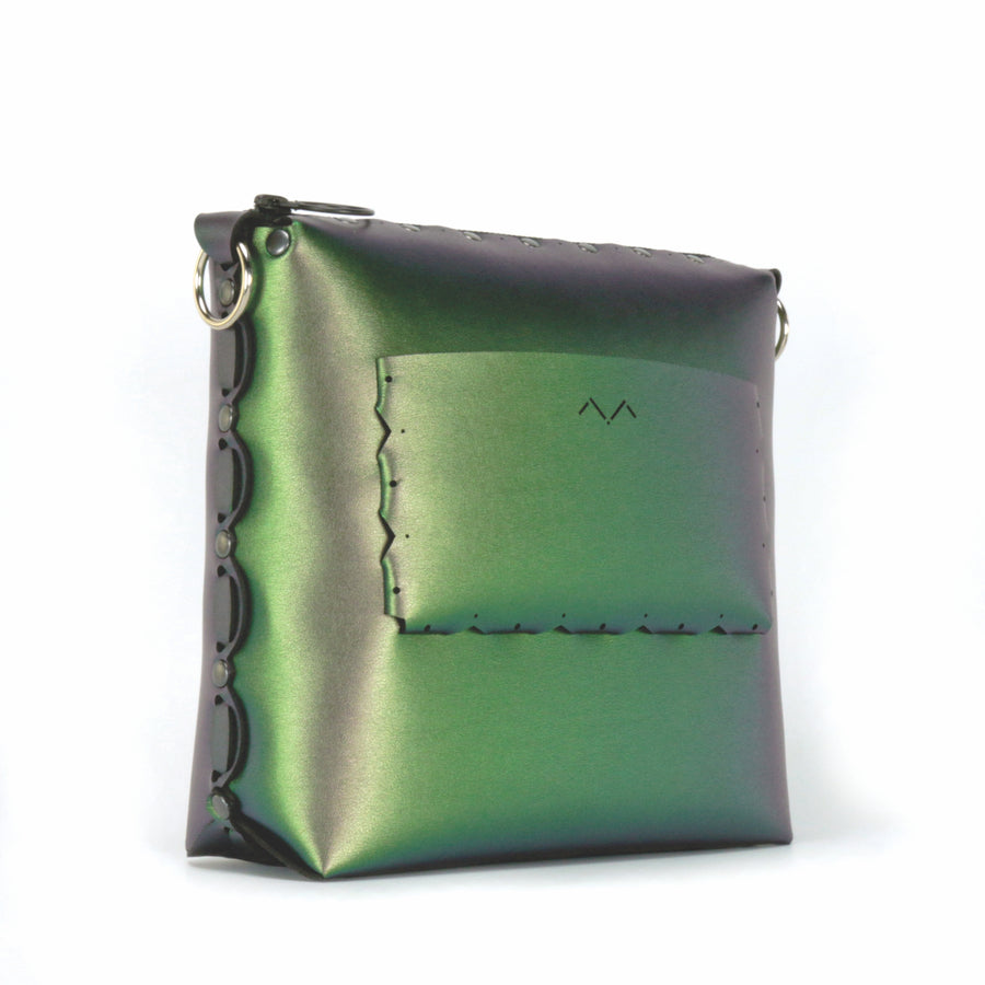 Side rear view of emerald medium crossbody bag